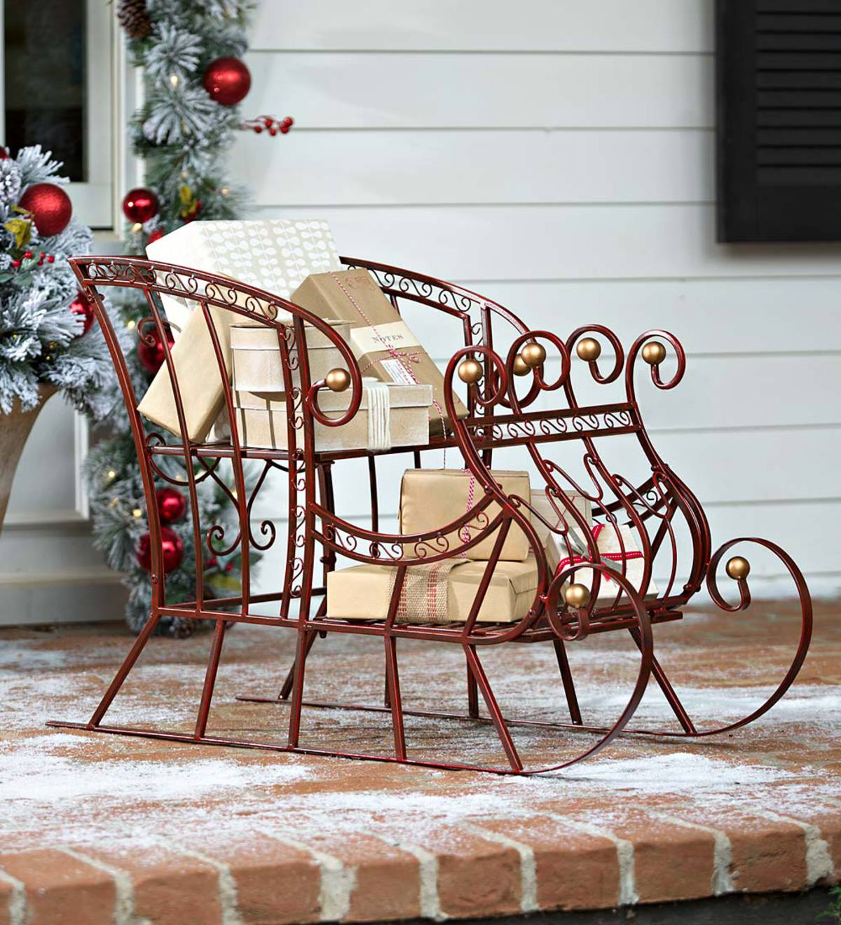 red metal holiday sleigh