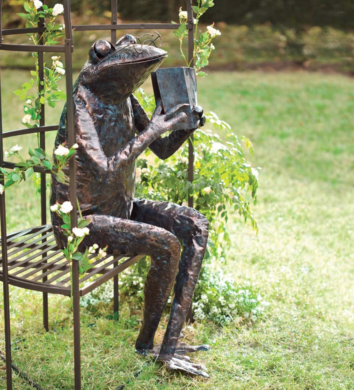 metal frog reading sculpture