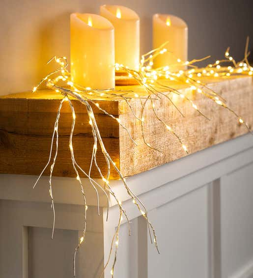 Image of Lighted Garland and Flameless Pillar Candles. Shop Holiday Lighting